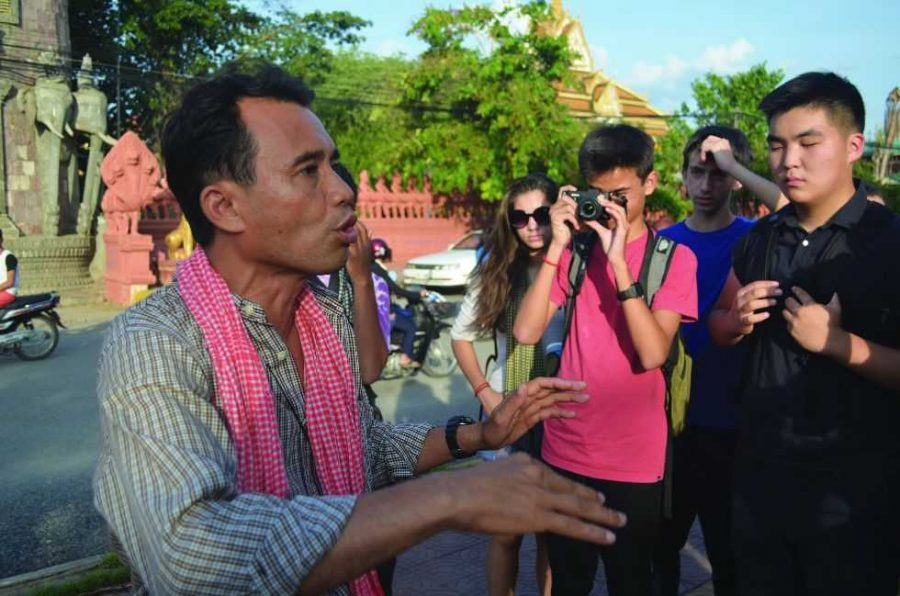 Arn Chorn-Pond shows students around Battambang, his home town. Pond is a survivor of the Cambodian genocide and a human rights activist committed to the preservation of Cambodian music. Prior to the trip, Chorn-Pond visited the Upper School on April 13 to be interviewed by students.