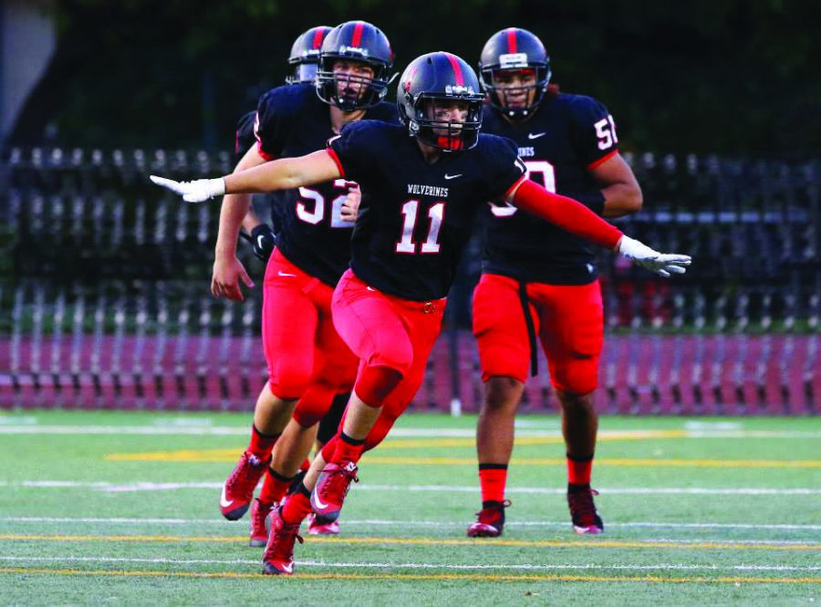 Mike Mapes '16 celebrates a sack during the football team's 44-23 victory against Jefferson High School Sept. 4. Credit: Harvard-Westlake Athletics Department, used with permission.