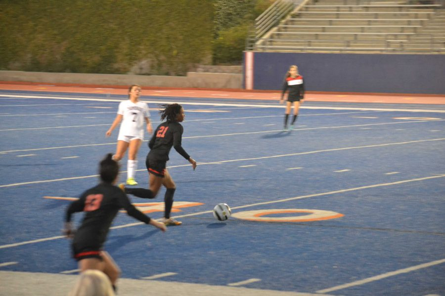 Press the advantage: Courtney Corrin dribbles the ball down the field in a match against Chaminade last year. Credit: Jonathan Seymour