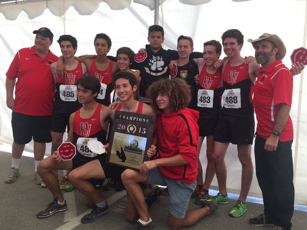 Winner winner: The Boys' Cross Country Team poises with their plaque after winning CIF-SS.  Credit: HW Athletics.