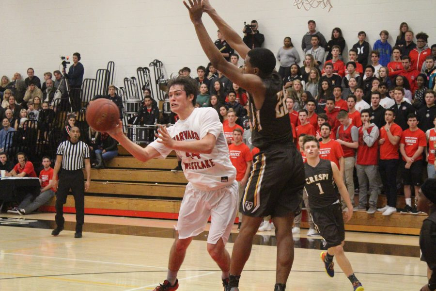Wolfgang Novogratz '16 passes to an open teammate in the corner. Credit: Cameron Stine '17/Chronicle