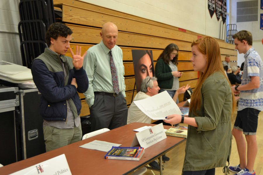 Kat Edmiston '17 talks to Agustin Letelier '16 and history teacher David Waterhouse about the AP Comparative Government course offered to seniors. Credit: Teresa Suh/Chronicle