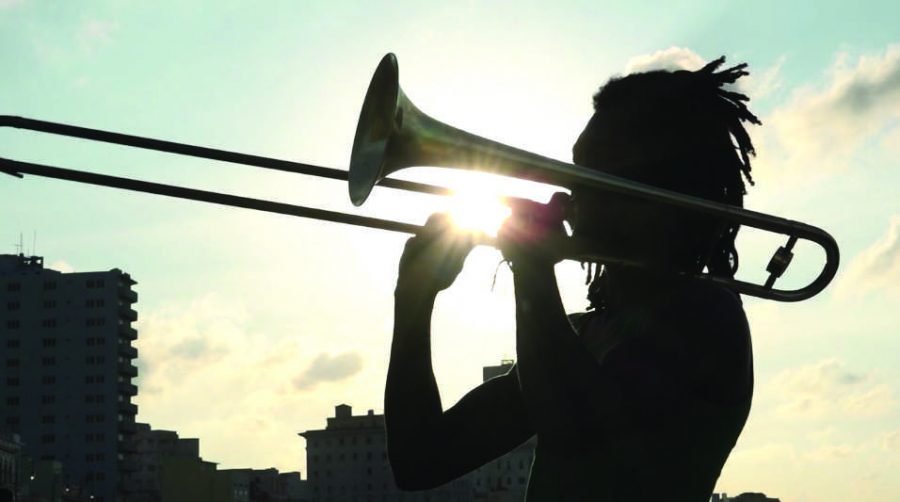 """MOVIE MAGIC: The documentary """"Embargo on Love"""" follows a young, female filmmaker who uses her camera to bring love to the once forbidden island of Cuba. The scene shows a man playing his trombone. Printed with permission of Cheri Gaulke"""