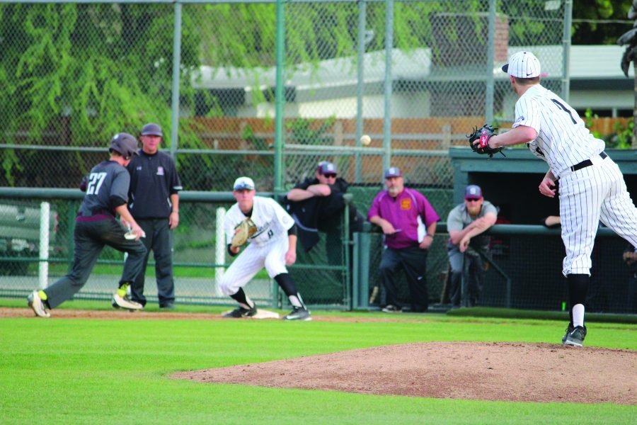Pitcher Benjamin Geiger '17 attempts to pick off an opponent during a league game. Credit: Bennet Gross/Chronicle