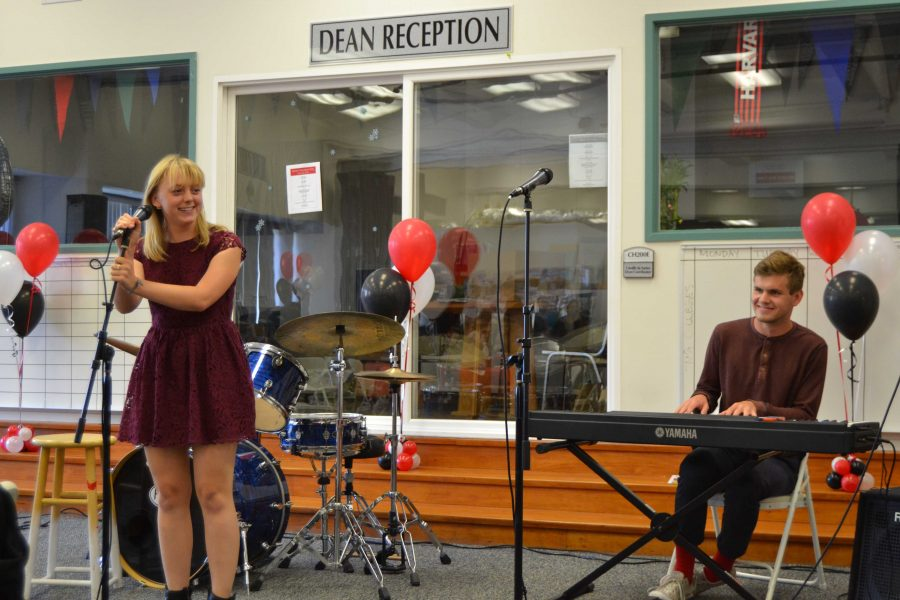 Elizabeth Edel '16 sings a song, accompanied by Michael Edwards '16 on piano.