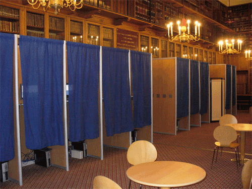 A typical voting booth. Image licensed for reuse with modification from Wikimedia Commons.