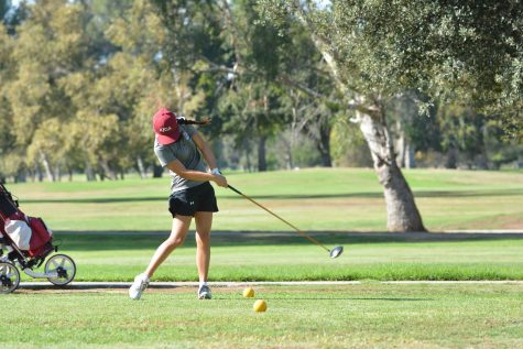 Karina Guo tees off during the Wolverines