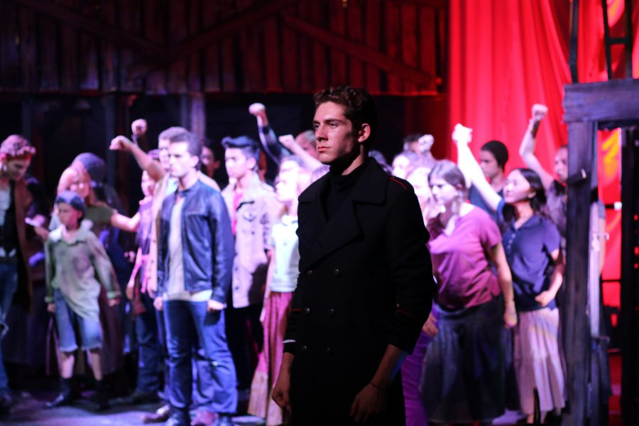 Ben Pimstone, who plays Javert, poses as the first act of