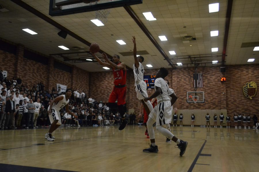 Cassius Stanley drives to the basket in 3rd quarter of CIF-Southern Section Division 1A semifinal against Loyola. (Aaron Park/Chronicle)