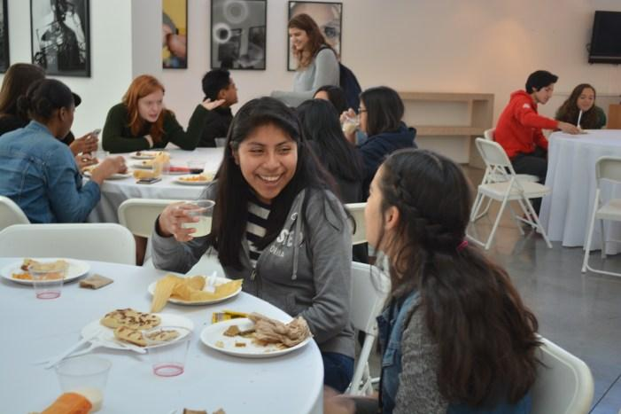 Aileen Cano '18 talks with another student at a multicultural brunch designed to foster diversity at the Feldman-Horn Gallery on Jan. 30. The brunch meant to give students an opportunity to come together, regardless of their ethnicity. Credit: Sophie Haber/Chronicle