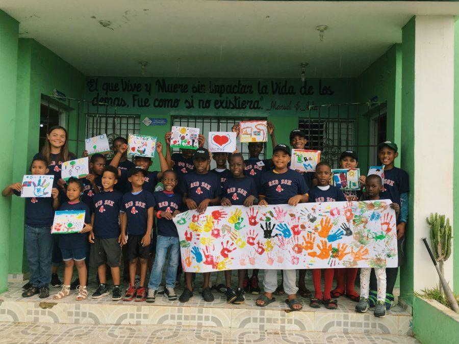 Keila McCabe '20 poses with her art students in the Dominican Republic. Credit: Keila McCabe/Chronicle