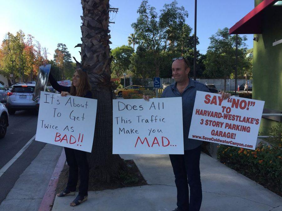 Protesters stand on the corner of Coldwater Canyon and Ventura with her poster. Neighbors gathered to protest the construction of the proposed parking structure. Credit: Save Coldwater Canyon