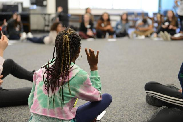 Student poses a question during a workshop at the Across Colors Diversity Conference. Credit: Jenny Li/Chronicle