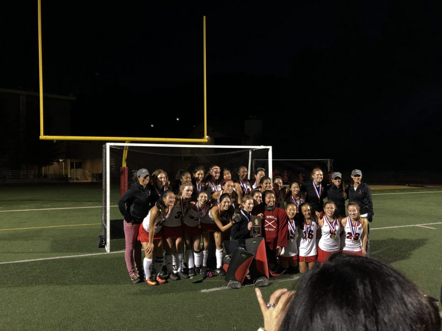 After a perfect season, the girls' field hockey team poses after defeating Newport on Saturday. Photo Credit; Lucas Gelford/Chronicle