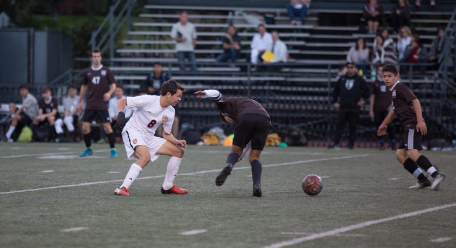 William Roskin '18 jukes out opponent during Senior Night against Crespi. The team won the game 5-0. Photo Credit: Pavan Tauh/Chronicle