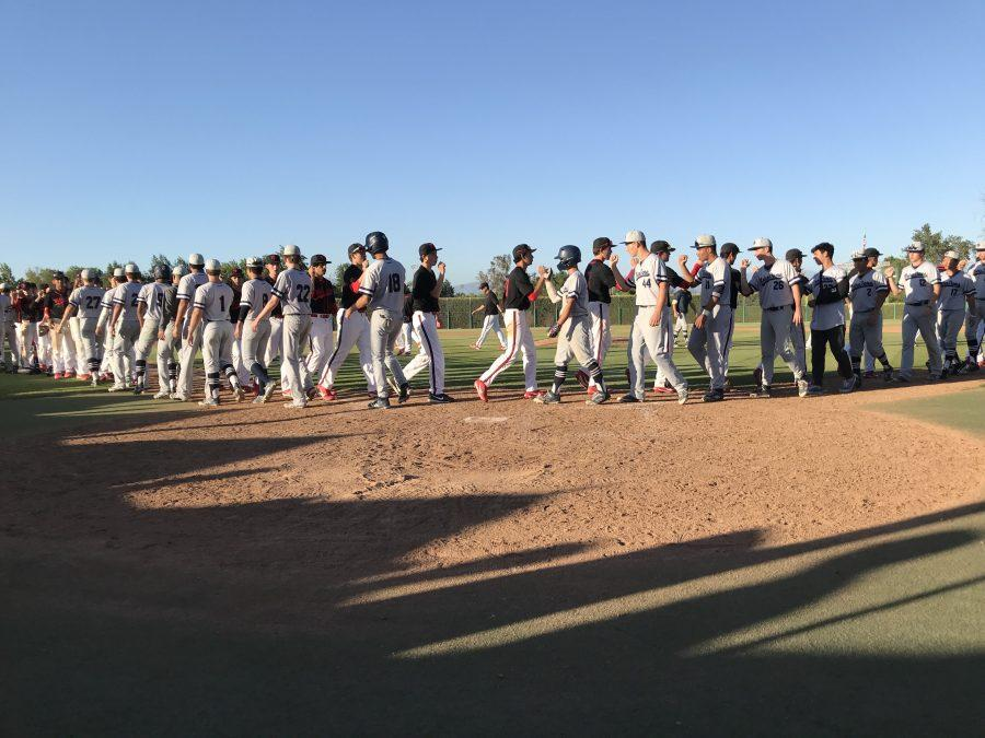 Notre Dame and Wolverine players shake hands after the Wolverines 8-4 victory Friday. Credit: Aaron Park/Chronicle