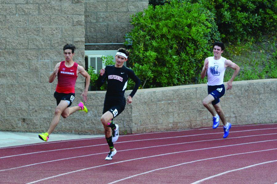 (Left to right) Bradyen Borquez '19 and Jack Riley '19 compete in the 200-meter race in the race against Loyola. Photo Credit: Ryan Kim/Chronicle
