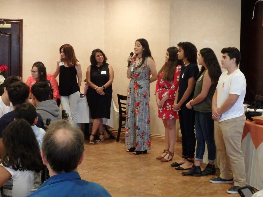 Xenia Bernal '19 speaks alongside fellow LAHSO members in front of faculty, students and parents about unifying as a community. Credit: Tammer Bagdasarian/Chronicle
