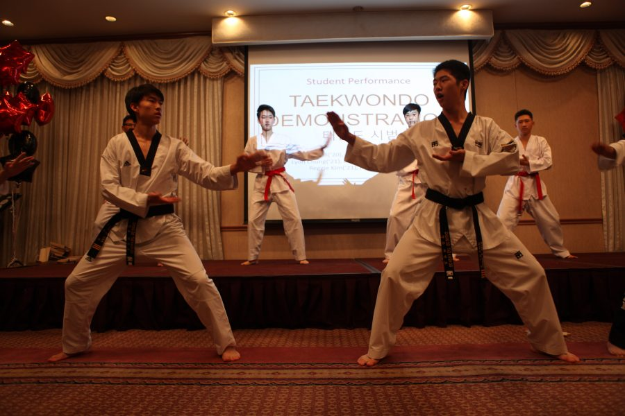 Student members of KAPA performed taekwondo to showcase various aspects of Korean culture to the school administration. Credit: Caitlin Chung/Chronicle
