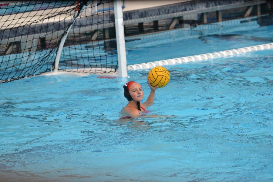 Emily Hilliard '19 passes the ball from the goal. Credit: Kyle Reims / Chronicle