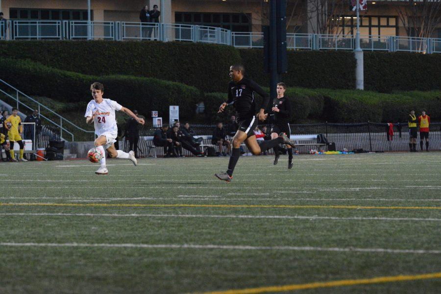 Forward Langston Holly '20 tries to beat his defender to the ball in the 6-0 win against Alemany High School today. Holly scored the first goal of the game on this possession. Photo Credit: Luke Casola/Chronicle.