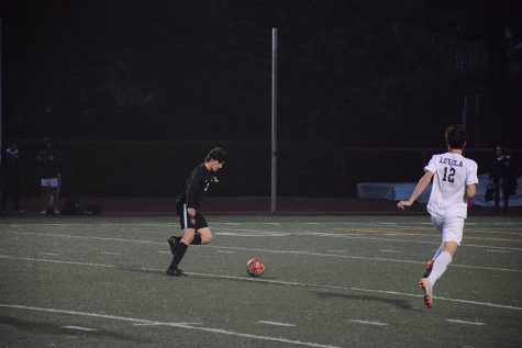 HAPPY FEET: Gabe Palacios '20 looks to score in the Wolverine