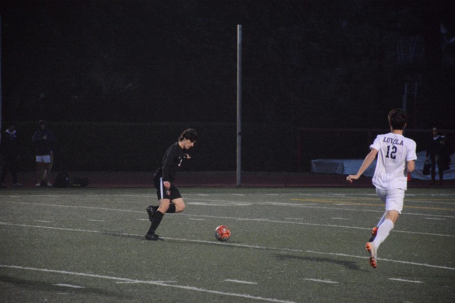 HAPPY FEET: Gabe Palacios '20 looks to score in the Wolverine's 4-1 loss to rival Loyola High School at home Jan. 11.  Midfielder Lucca Dohr '20 was the lone scorer for the Wolverines. Photo credit: Keila McCabe/Chronicle.