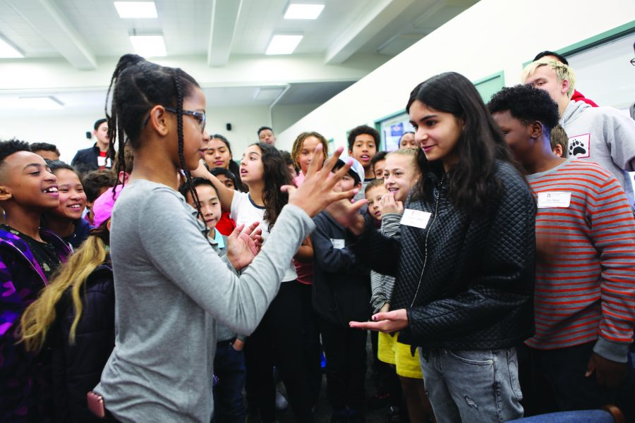Two prospective students play a game of rock-paper-scissors at the Multicultural Fair. The event was hosted by the Student Ambassador program with the purpose of creating an inclusive environment for applicant families of color.   Credit: Caitlin Chung.