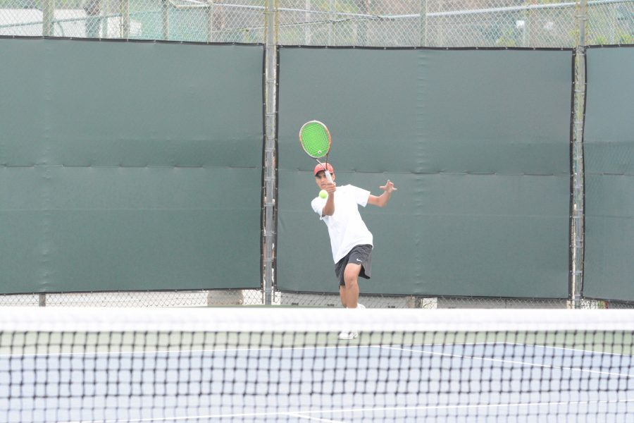 Amaan Irfan '21 returns a serve in his doubles match with teammate Avi Carson '22. The squad beat St. Francis 13-5 Tuesday.