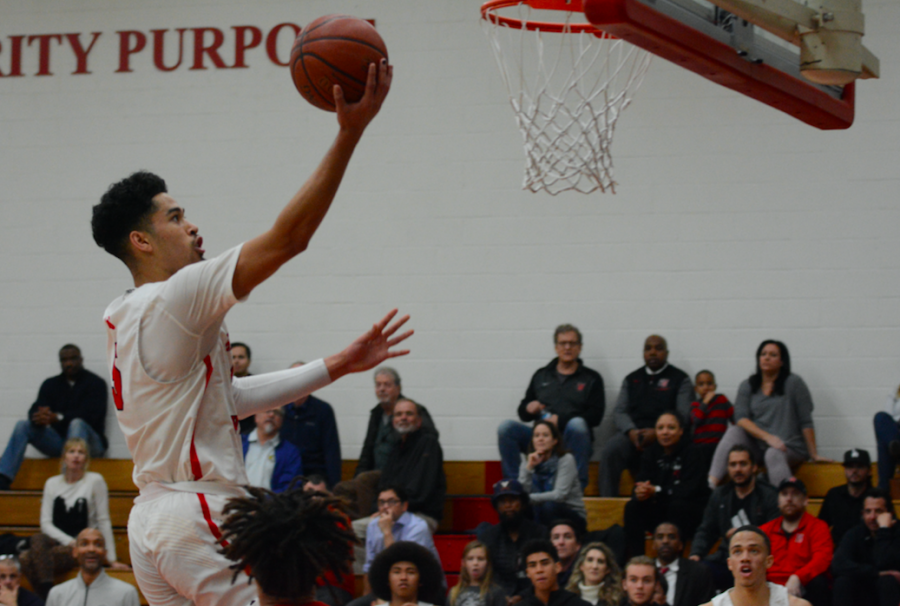 Guard Johnny Juzang '20 drives to the basket for a layup in his 30 point game against Redondo Union High School. Credit: Keila McCabe/Chronicle