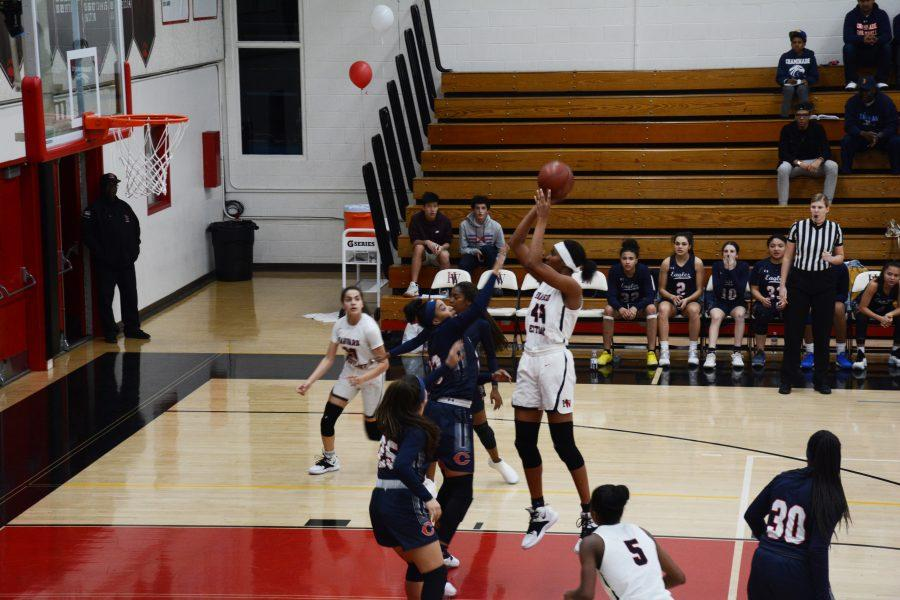 Star Forward Kiki Iriafen '21 jumps and shoots against Chaminade High School on Jan. 29. (Credit: Will Mallory/Chronicle)
