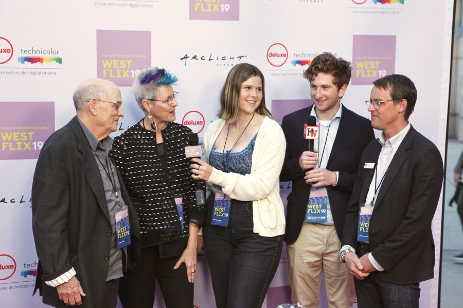 Annie Wendorf  '19 and Jack Safir '19 interview performing arts teacher Ted Walch, visual arts teacher Cheri Gaulke and visual arts teacher Jesse Chehak '97 at the Westflix red carpet premier. The event featured writer and director Bo Burnham. Credit: Caitlin Chung