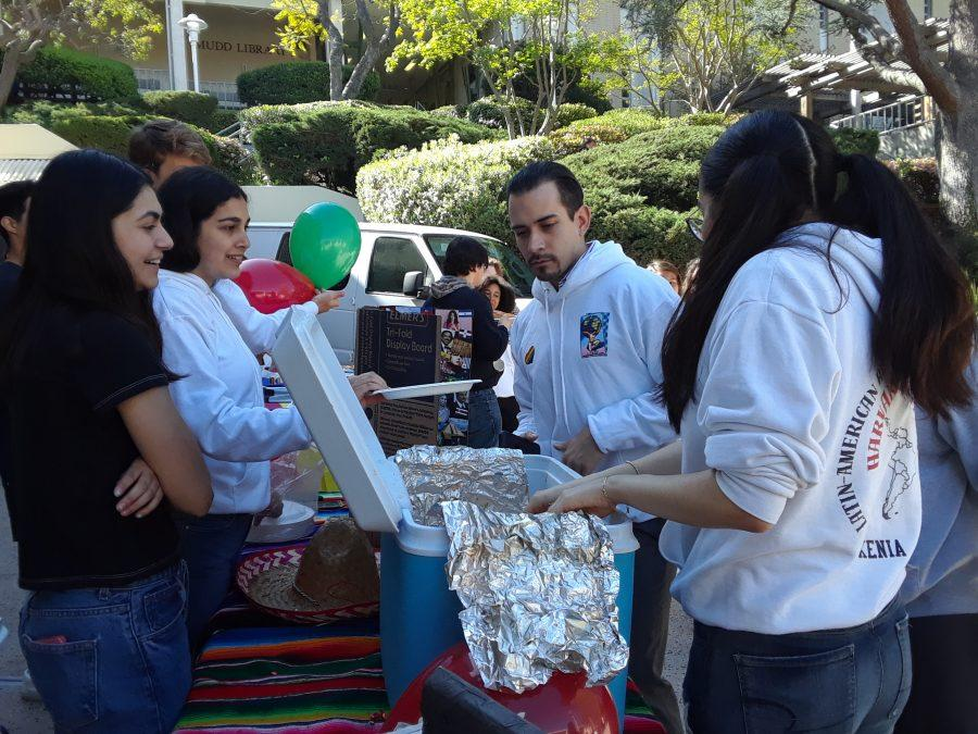 Students of LAHSO distribute food to students at the Multicultural Fair.  Credit: Tanisha Gunby/ Chronicle