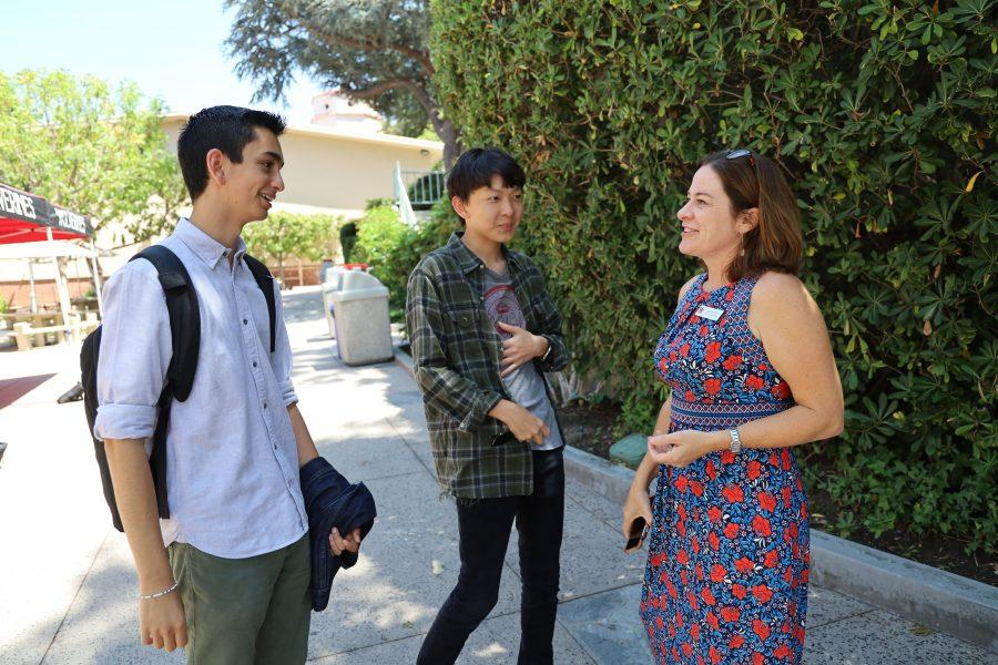 QUAD TALK: Head of Upper School Laura Ross talks with Michael Lehrhoff '20 and Justin Park '20 on the quad. Ross will assume her new position in just under a year.  In the meantime, Debbie Reed will serve as the Interim Associate Head of School.
