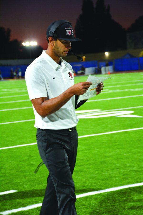 LAMBO: Interim head coach Ramsey Lambert patrols the sideline during the season opener against Birmingham High School.