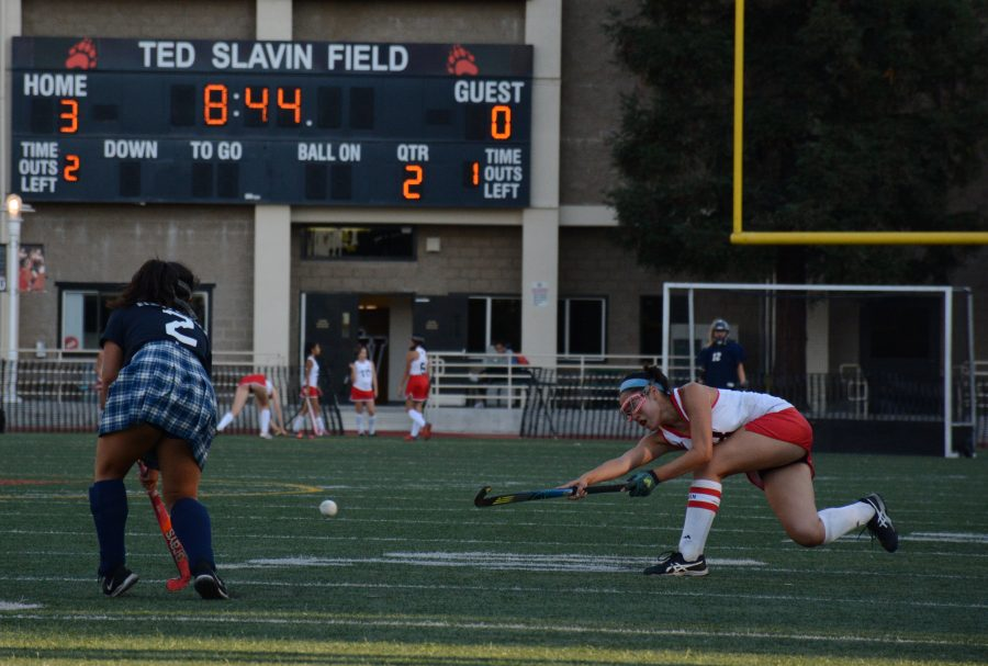 Chronicle staff member and field hockey co-captain, Astor Wu '20 passes the ball through the Newport Harbor defense. Credit: Lucas Lee/Chronicle
