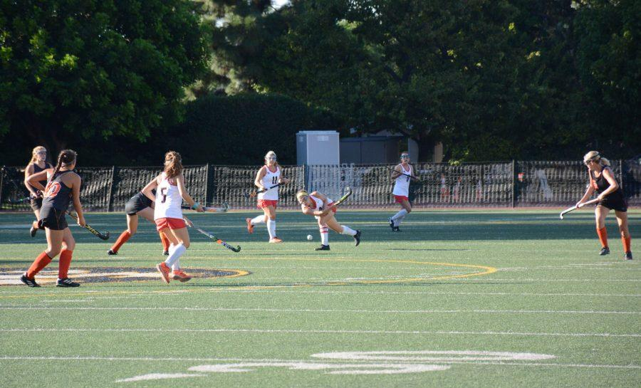 Captain Rachel Brown '20 moves the ball up-field in a 2-1 win against Huntington Beach High School. Credit: Lucas Lee/Chronicle