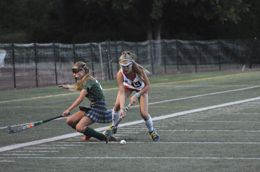 Fienne Oerlemans '22 breaks a Newport Harbor defender's ankles in a 2-1 win. Credit: Lucas Lee/Chronicle.