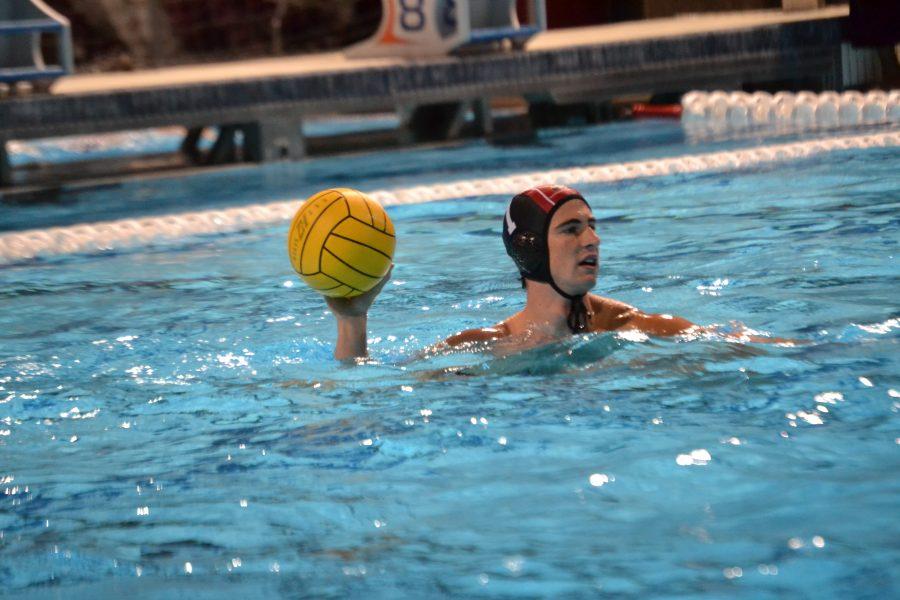 Goalkeeper Nolan Krutonog '20 surveys the pool for teammates in the match against Loyola High School. Credit: Sandra Koretz/Chronicle