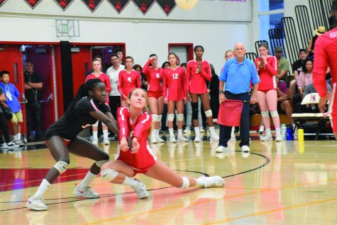 Captain and libero Josephine Amakye '21 and outside hitter Ava-Marie Lange '23 lunge for the ball in order to keep the rally. The girls won against the Buckley School for Girls 3-0. Credit: Eugean Choi/Chronicle