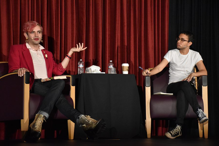 "Non-binary activists Jacob Tobia and Tyler Ford engage in a conversation about gender and sexuality Nov. 6 in Taper Gym. Both speakers encourage students to overcome the stigma associated with ""coming out"" and transcend gender stereotypes. Credit: Crystal Baik/Chronicle"