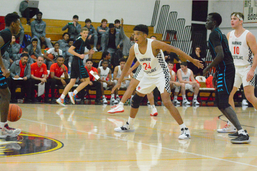 Guard Cameron Thrower '22 defends the opposing player while preparing for a screen in a 58-52 win against Renaissance Academy Nov. 21. Credit: Jaidev Pant/Chronicle