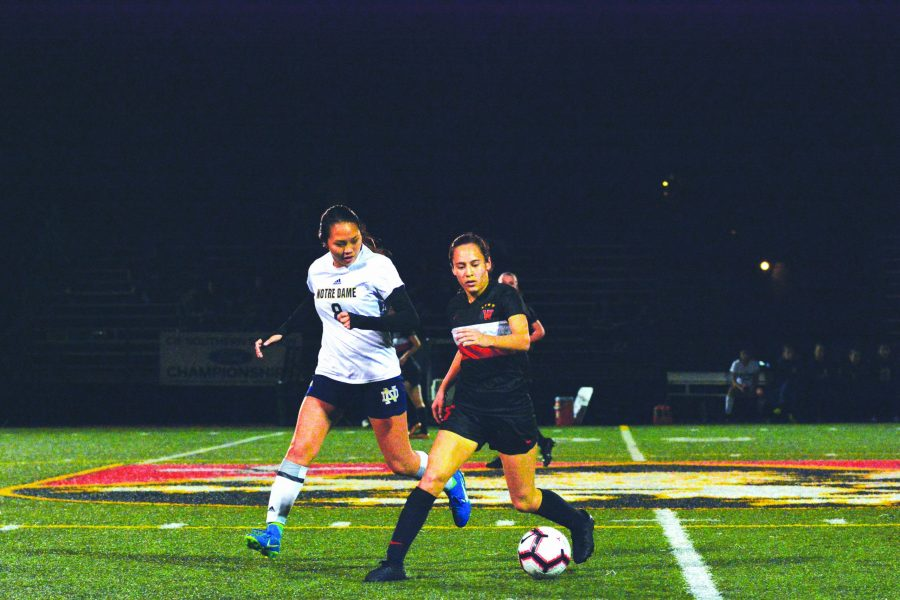 NAT ATTACK: Natalie Barnouw '21 protects the ball against a Notre Dame High School defender on senior night in a 1-0 win in the last Mission League game of the season at Ted Slavin Field. Credit: Lucas Lee/Chronicle