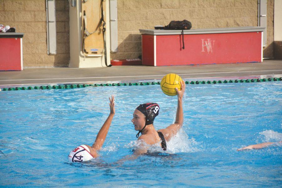 Attacker Meera Burghardt '20 looks to shoot the ball against Redondo Union High School on Jan. 18. Credit: Kyle Reims/Chronicle
