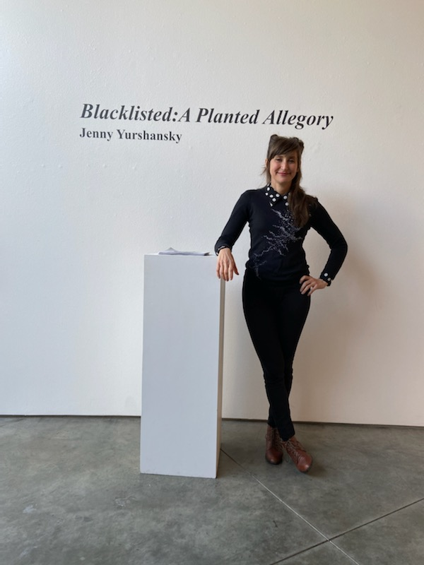 Mixed media artist Jenny Yurshansky opens her art exhibition, Blacklisted: A Planted Allegory, to students and faculty during her opening reception in Feldman-Horn Gallery on Jan. 10. Credit: Crystal Baik/Chronicle