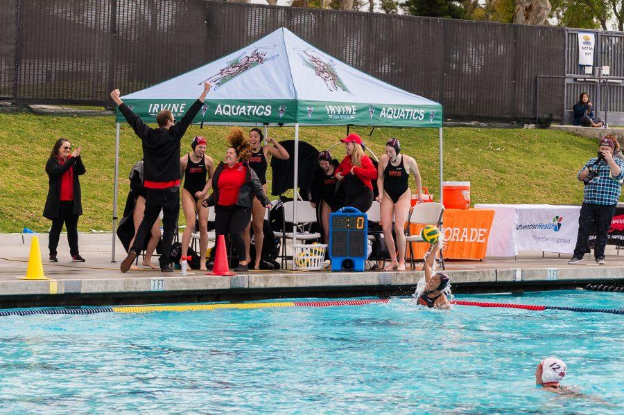 Matt Kubeck and the girls' water polo team celebrate as time expires in the CIF Division II Finals.  Credit: Wu Sim