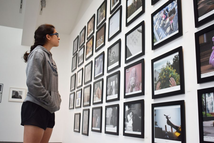 Valentina Gaxiola '21 views various photography projects located in the Feldman- Horn Gallery. The art exhibit showcased works taken by Photography I and II students.