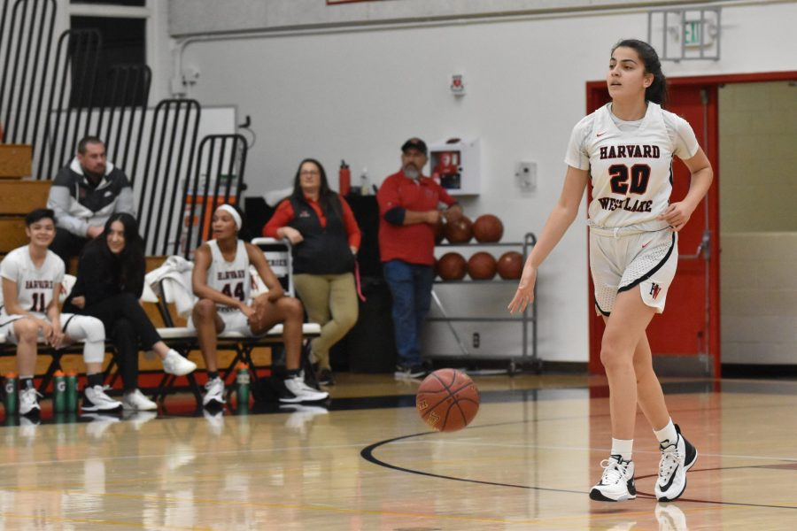 Guard Krista Semaan '21 sets up the offense in a 75-31 win against La Canada High School in the Brentwood Invitational. Semaan finished with 12 points against the Mustangs tonight. Credit: Jaidev Pant/Chronicle
