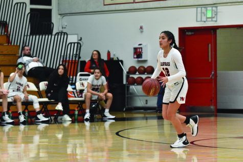 Una(Paula)getic: Guard Paula Gonzalez '21 surveys the frontcourt in a 75-31 win at home against La Cañada High School on Dec. 4 in the Brentwood Invitational. The Wolverines went on to win the Mission League title after finishing with a 7-1 league record.