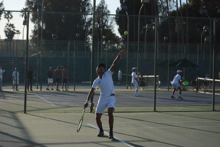 Pat Otero '21 prepares to serve the ball in a 15-3 win at home against Palos Verdes High School on Mar. 3. Otero won all three of his matches against the Sea Kings.